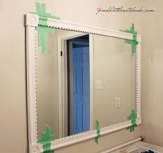 framing bathroom mirror with molding how to frame out that builder s grade mirror the easy way