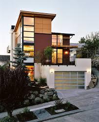 modern garage doors with door slate siding grasses front porch