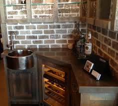inspiring faux brick backsplash with corner kitchen cabinets as