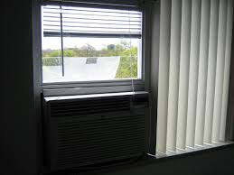 Hang Curtains Higher Than Window by Mounting A Standard Air Conditioner In A Sliding Window From The