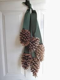 holly goes lightly diy pine cone door hanger