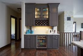 wine rack with small lighted cabinet accents and mini fridge