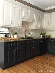 two tone kitchen cabinets with black countertops black kitchen cabinets the at home with the barkers