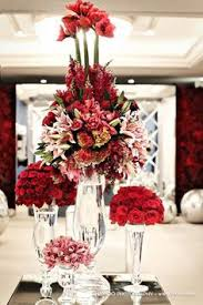 Red Rose Table Centerpieces red roses and stephanotis waterfall bouquets almost identical to