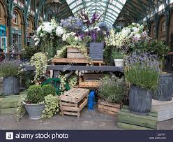 an eliza doolittle inspired flower stall at covent garden market