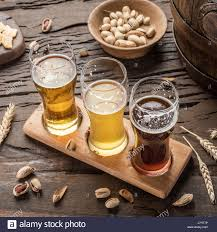 Wooden Table Top View Glasses Of Beer And Snacks On The Wooden Table Top View Stock