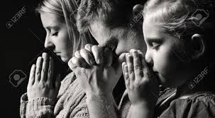praying family man woman and child stock photo picture and