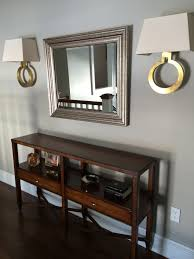 Visual Comfort Sconces Visual Comfort Ring Form Wall Sconces Used Over A Console Table