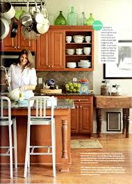 how to lighten dark cabinets without painting quick tip for lightening up a dark kitchen emily a clark