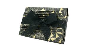 creative gift wrapping with reverse japanese pleats on gold foil