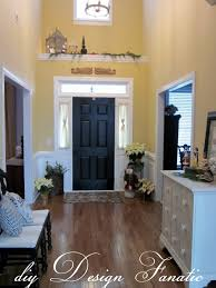 Modern Foyer Decorating Ideas Enchanting Black Painted Front Doors With White Drawers Cabinets
