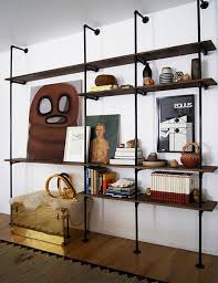 neat wall shelving mounted on what appears to be plumbers piping