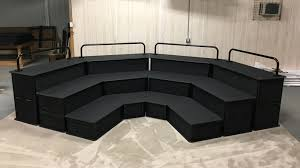 choir riser system with chair rail and safety railings feather block