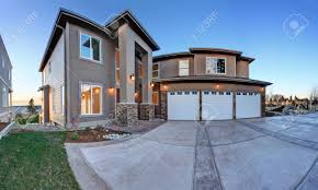 Three Car Garage Luxury House Exterior With Three Car Garage And Driveway Evening
