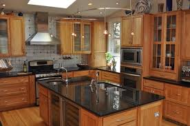 black granite countertops with maple kitchen cabinets pictures