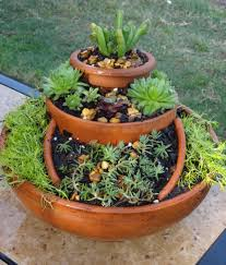 garden made out of broken pots i used succulents moss u0026 potting