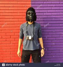 Gorilla Mask Halloween by Man Wearing A Gorilla Mask With A Camera Around His Neck Standing