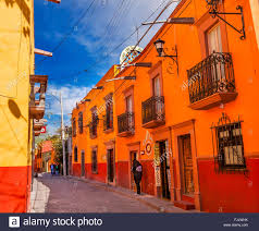 town street tourists hotels san miguel de allende mexico stock