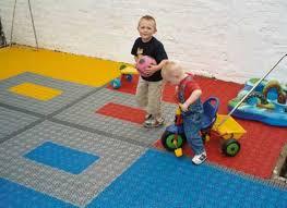 backyard play area flooring using interlocking plastic floor tiles