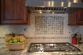 interior fasade backsplash with black cooktop and granite