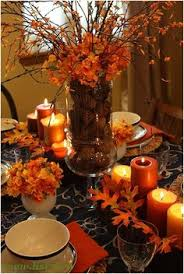 fall centerpiece ideas leaves and orange candles make for the intimate