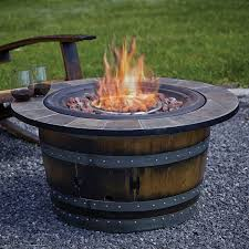 wine barrel fire table reclaimed wine barrel fire pit with slate top wine enthusiast