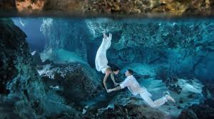 underwater trash the dress in a deep cenote riviera maya mexico