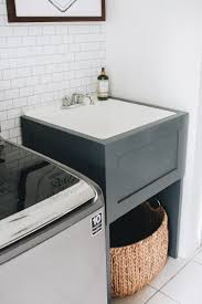 how to install base cabinets in laundry room how to hide your utility sink faux cabinet tutorial