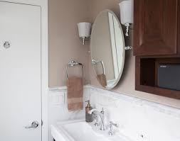 this oval tilt mirror and sconces really complete the look of this