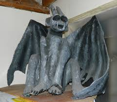 big gargoyle 4 feet across made of paper mache with eyes that