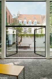 Outdoor Glass Room - indoor outdoor rooms via vogue living