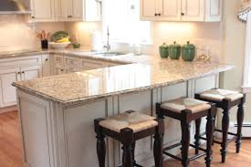 u shaped kitchen with breakfast bar white granite countertop