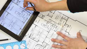 the house designer with tablet pc a draftsman using a technical