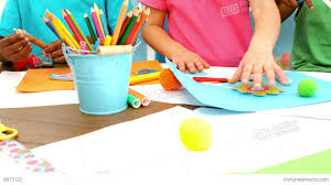 kids playing together with arts and crafts items stock video