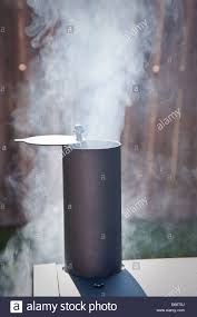 backyard smoker making texas barbeque with mesquite stock photo