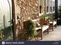 potted plants and benches in front of house stock photo royalty