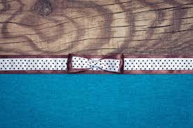 and white polka dot ribbon vintage background with wood blue paper and brown and white polka