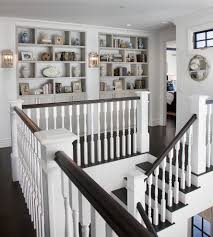Coastal Home Design Studio Llc Gorgeous Coastal Stairway With Dark Wood Floors And White Pillars