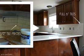 how to cut tile around cabinets duo ventures kitchen makeover subway tile backsplash