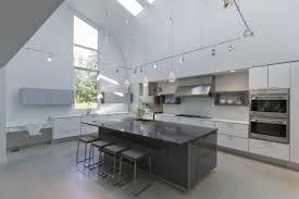 striking grey kitchen island white cabinets with kitchen pendant track lighting fixtures also white milk glass