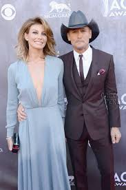 tim mcgraw s big cowboy hat almost distracts from faith hill s