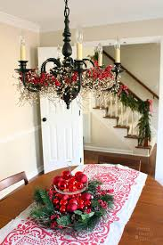 add garland around the base of a chandelier for and pretty