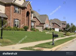 upscale neighborhood beautiful brick homes landscaped stock photo