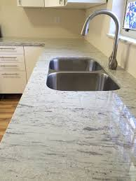 white kitchen cabinets with river white granite river white granite kitchen traditional with chicago heating