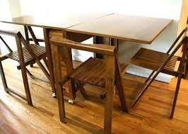 drop leaf table with folding chairs stored inside table with chair storage folding dining table and chairs folding