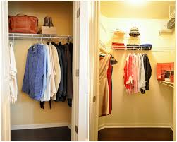 closet organizer for office equipment with blue wall paper and white stained wooden walk closet