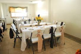 burlap table runner on white polyester tablecloths champagne and
