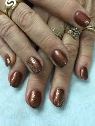 cool copper brown gel nails with gold accents all done with non