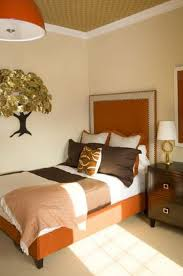 ravishing cream small bedroom design with warm bed at corner and