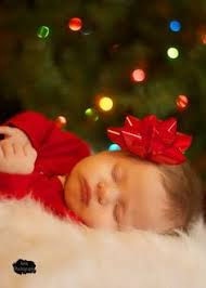 want my kids to take a picture like this at their first christmas